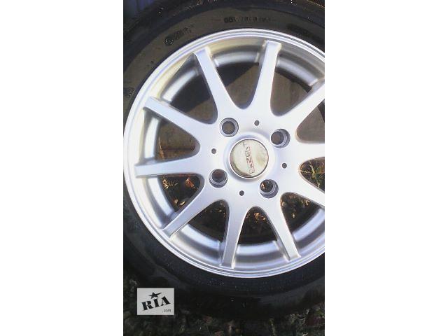 купить бу Б/у диск для легкового авто Dezent R14 4/114.3 в Львове