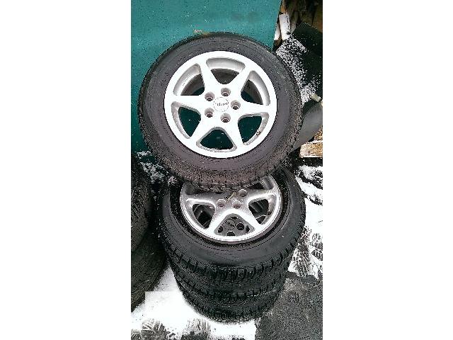 продам Б/у диск с шиной для хэтчбека Volkswagen Golf V Titan R15 бу в Житомире