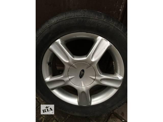 купить бу Б/у диск с шиной для легкового авто Ford Focus в Гайсине