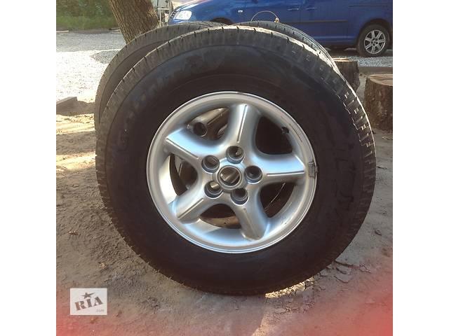 продам Б/у диск с шиной для легкового авто Land Rover бу в Львове