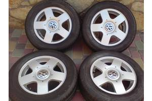 б/в Диски з шинами Volkswagen Golf