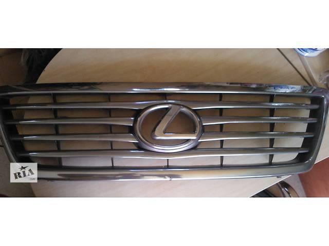 купить бу эмблема б/у решётки радиатора для кроссовера Lexus LX 470 в Луганске