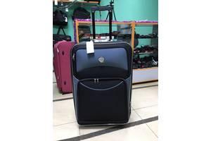 Большой чемодан, на 8 колес, все колеса на одной оси, надежность системы говорит сама за себя, черный\серый