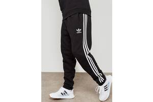 Теплые широкие спортивные штаны Адидас на флисе Зима Adidas на манжете байка