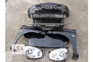 бампери передні Nissan Micra