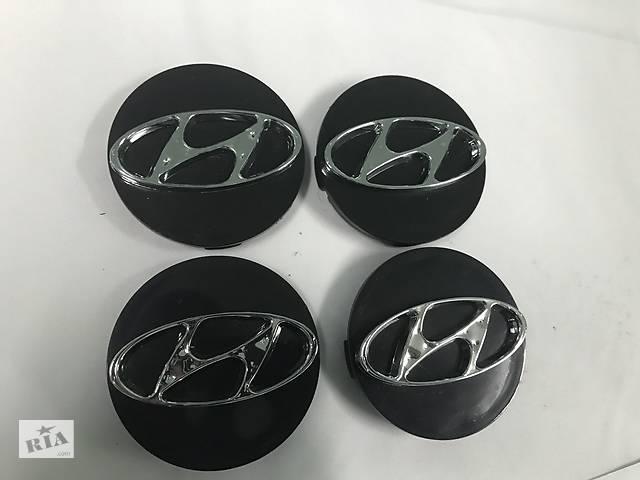 бу Hyundai Tucson JM 2004↗ гг. Колпачки в титановые диски 55 мм (4 шт) в Чернівцях