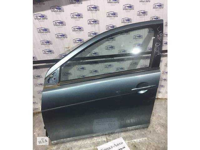 купить бу Дверь передняя левая Mitsubishi Lancer 10  запчасти Лансер 10 в Киеве