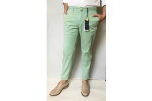 Нові чоловічі брюки MANGO