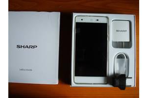 Нові Сенсорні мобільні телефони Sharp