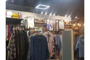 Продажа сети магазинов одежды