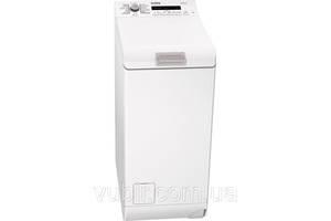 Новые Вертикальные стиральные машинки AEG