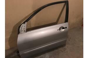Дверка ліва б/у Mitsubishi Lancer