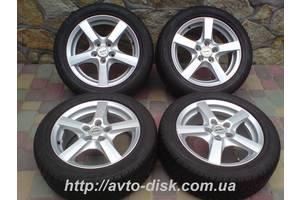 б/у диски с шинами Volkswagen Golf V