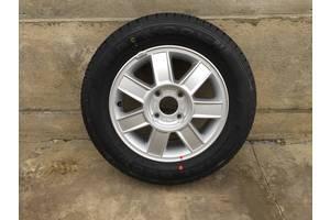 Новые диски с шинами Kia Magentis